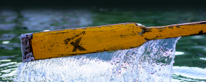 Rustic wooden oar blade with dripping water