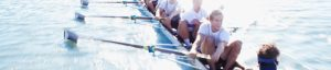 Collegiate rowers in an 8-man shell